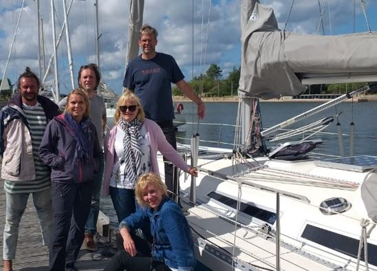 BEF LV group next to yacht