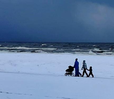 Family at snowy beach in Jurmala