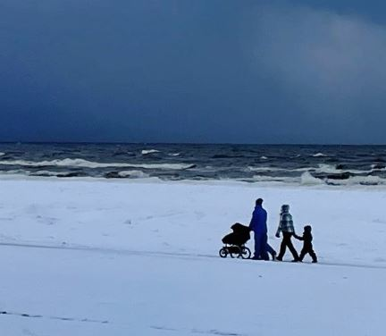 Family at snowy beach in Jurmala