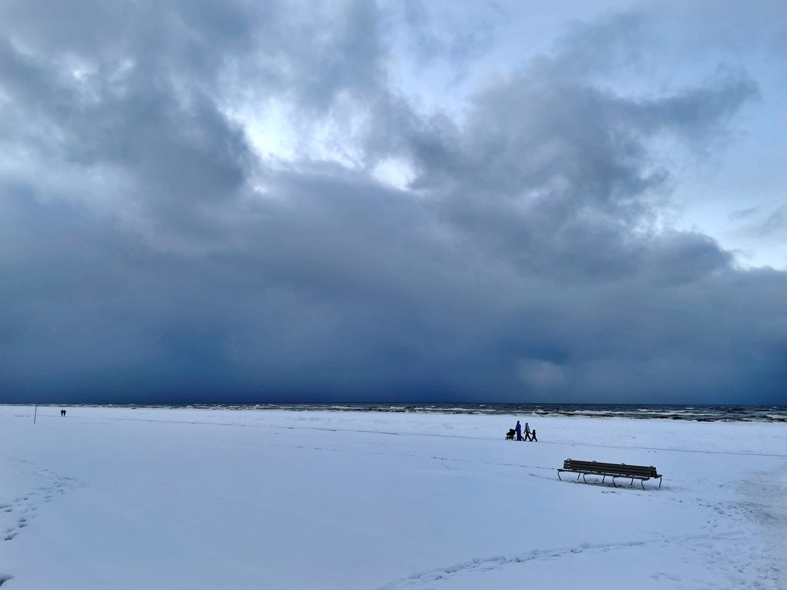 Family walking at winter beach 2021 Jurmala